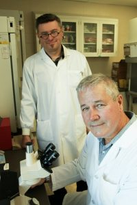 Lead scientist John Gordon (foreground) and Wojciech Dawicki (background)